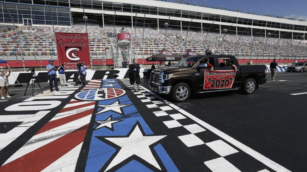 Graduating seniors drive across the start-finish line at the Charlotte Motor Speedway in Concord, N.C.,(AP Photo/Gerry Broome)