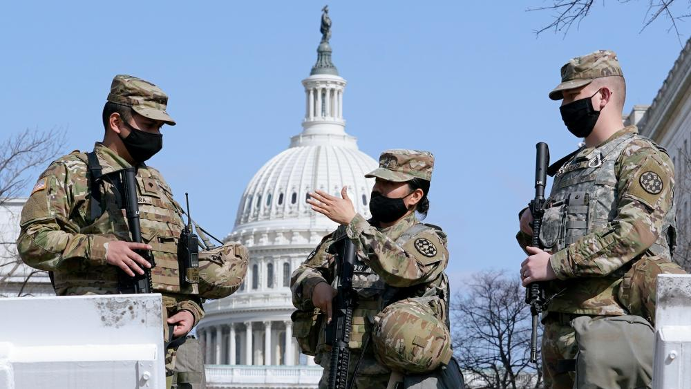National Guard stand guard at the Capitol in Washington, Thursday, March 4, 2021. (AP Photo/Carolyn Kaster)