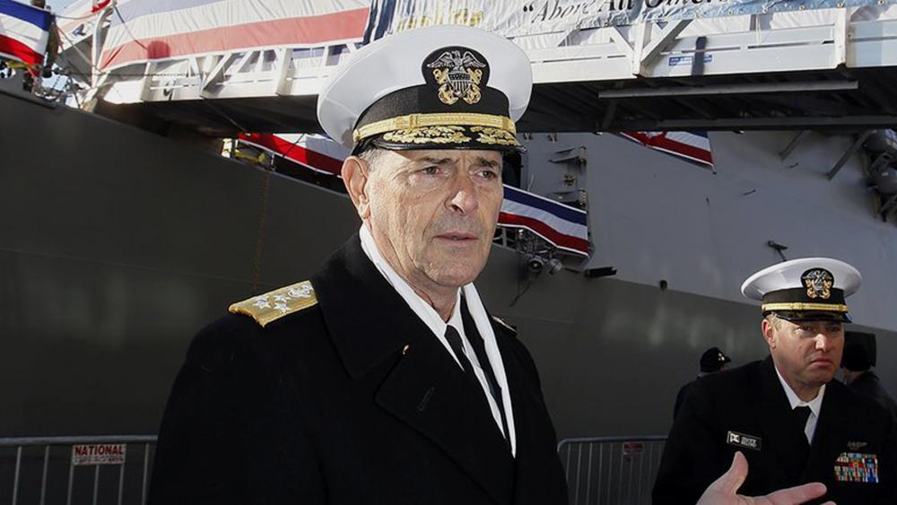 In this Dec. 1, 2018 file photo, Vice Chief of Naval Operations, Adm. William Moran describes the function of the USS Thomas Hudner prior to its commissioning ceremony in Boston. (Paul Connors/The Boston Herald via AP, File)