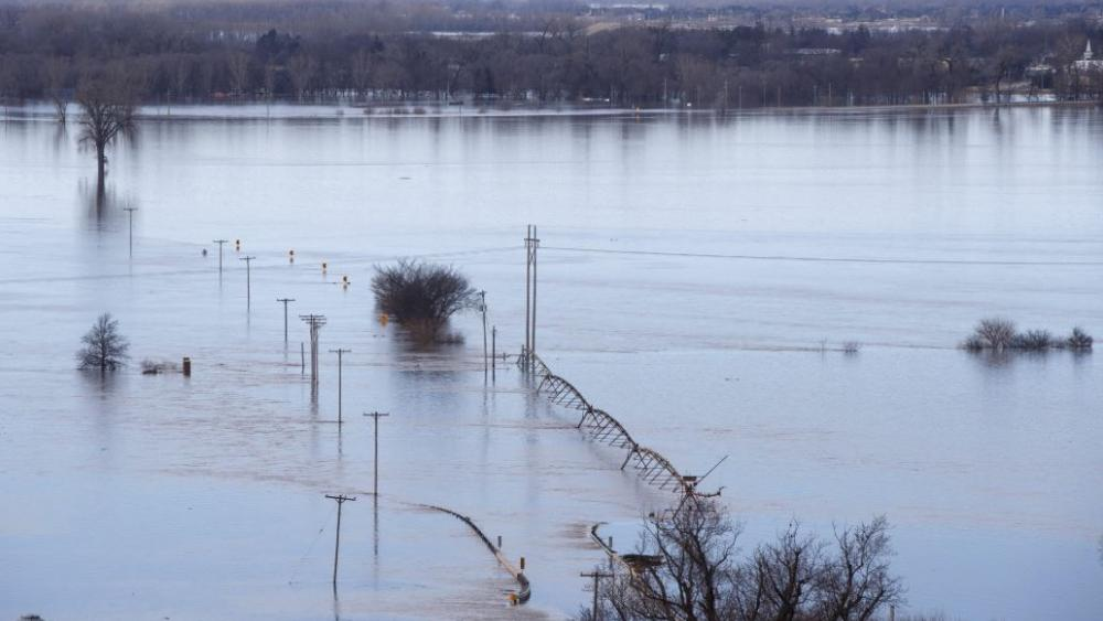 Looking southwest towards Waterloo Neb., high waters from the Elkhorn river cover Maple street in the distance Saturday March 16, 2019.  (Jeff Bundy/Omaha World-Herald via AP)