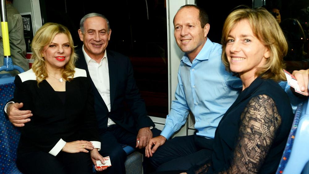 Israeli PM Benjamin Netanyahu and his wife, Sara, join Jerusalem Mayor Nir Barkat and his wife, Beverly, for a ride on the city's light rail, Photo, GPO archive, Kobi Gideon
