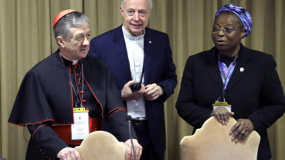 Sister Veronica Openibo, right, stands next to Chicago Archbishop Cardinal Blase J. Cupich, left, and Father Tomaz Mavric, center. (AP Photo/Alessandra Tarantino, Pool)