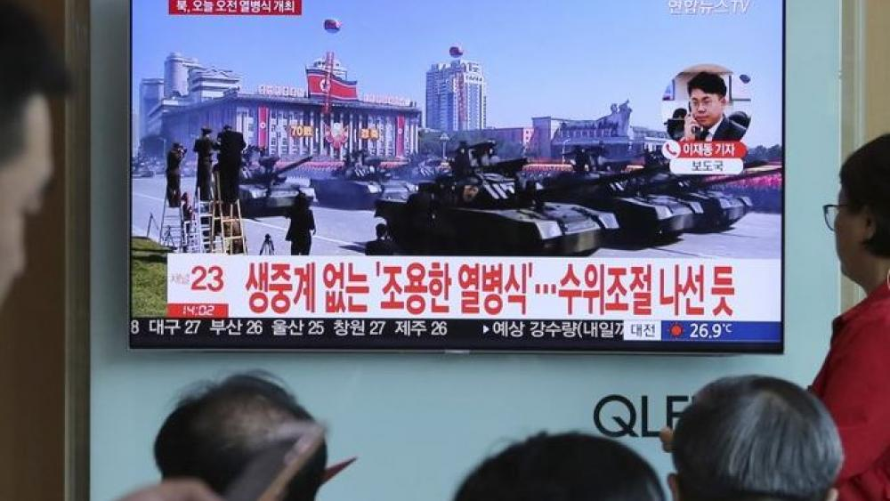 People watch a TV screen showing a parade for the 70th anniversary of North Korea's founding day in the Seoul Railway Station in Seoul, South Korea.