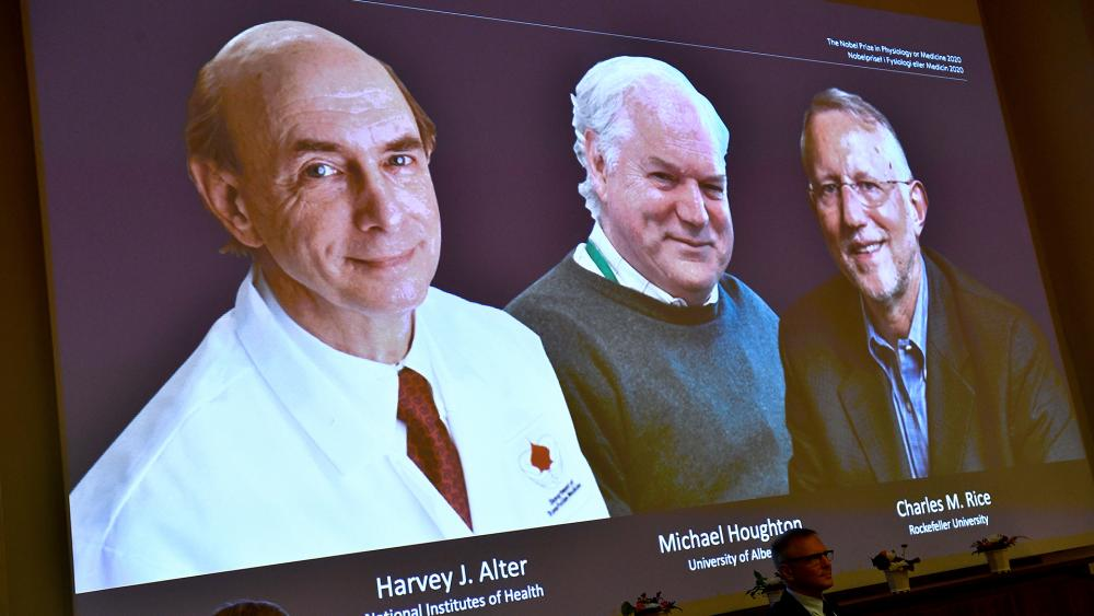 The Nobel Prize for medicine has been awarded jointly to Harvey J. Alter, left on screen, Michael Houghton, center, and Charles M. Rice for the discovery of the Hepatitis C virus. (Claudio Bresciani/TT via AP)