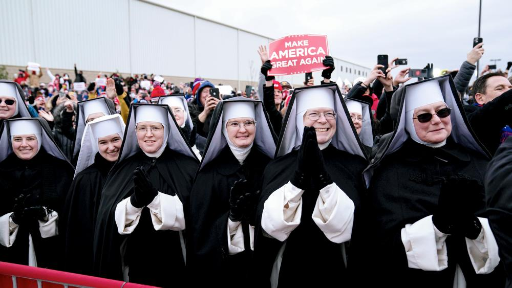 Nuns with the Dominican Sisters of Hartland, Mich., applaud as President Donald Trump (AP Photo/Alex Brandon)
