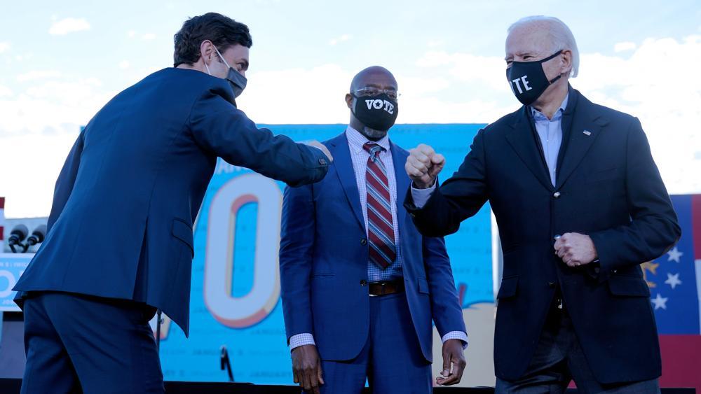President-elect Joe Biden campaigns in Atlanta, Jan. 4, 2021, for Senate candidates Raphael Warnock, center, and Jon Ossoff, left. (AP Photo/Carolyn Kaster)