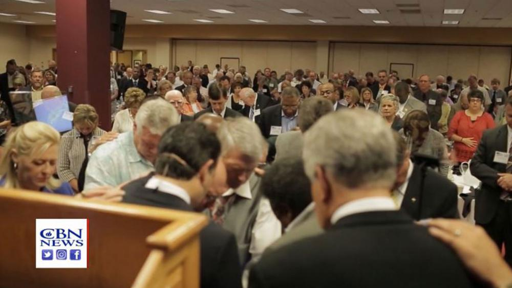 """Screenshot of pastors praying together at a previous """"Pastors and Pews"""" event. (Image credit: CBN News)"""