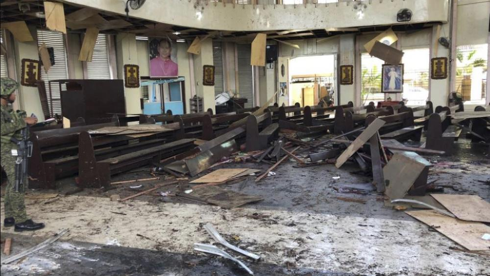 A soldier views the site inside a Roman Catholic cathedral in Jolo, the capital of Sulu province in the southern Philippines after two bombs exploded Sunday, Jan. 27, 2019. (Image credit: WESMINCOM Armed Forces of the Philippines Via AP)