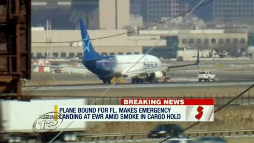 In this image taken from video provided by News12 New Jersey, Air Transat Flight 942 is towed along the runway at Newark Liberty International Airport, Saturday, March 9, 2019 in Newark, NJ. (News12 New Jersey via AP)