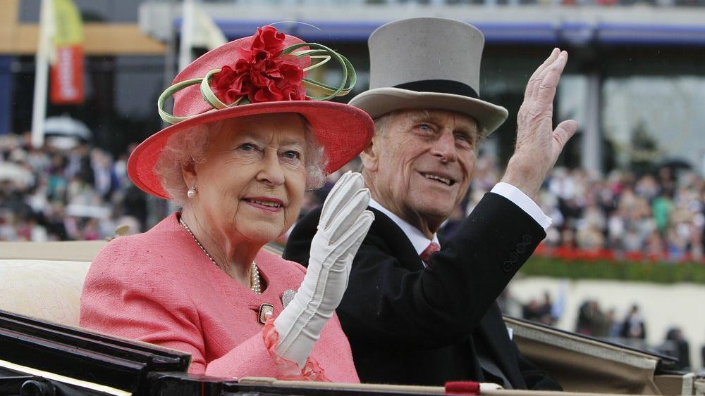 Britain's Queen Elizabeth II with Prince Philip on June, 16, 2011 (AP Photo/Alastair Grant, File)