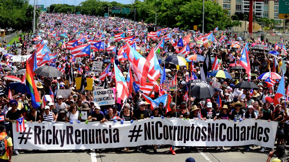 Thousands of Puerto Ricans gather for what many believe to be one of the biggest protests ever seen in the U.S. territory, pledging to drive Gov. Ricardo Rossello from office, in San Juan, Puerto Rico, Monday, July 22, 2019.  (AP Photo/Carlos Giusti)