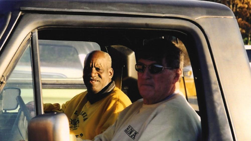 "(Image: Screen Capture) James ""Radio"" Kennedy with Coach Harold Jones"