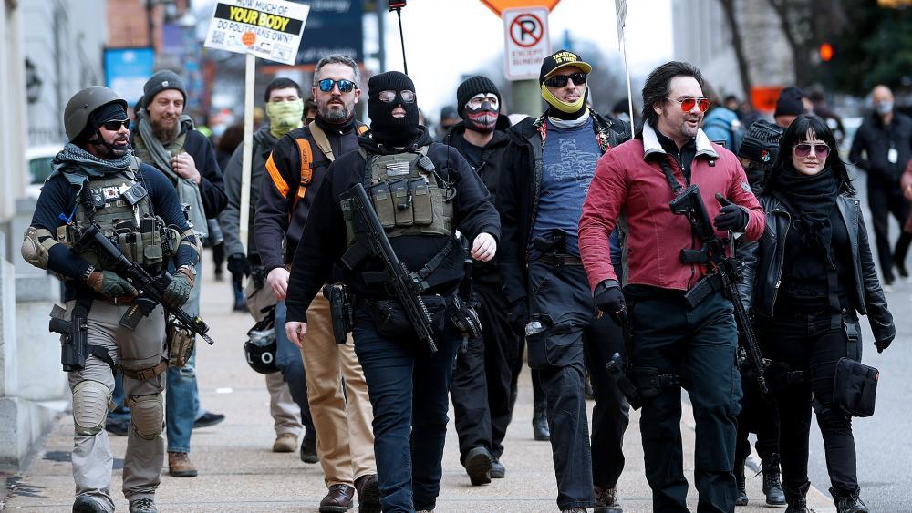 Gun rights supporters walk down Ninth Street in Richmond, Va., on Lobby Day Monday, Jan. 18, 2020. (Alexa Welch Edlund/Richmond Times-Dispatch via AP)