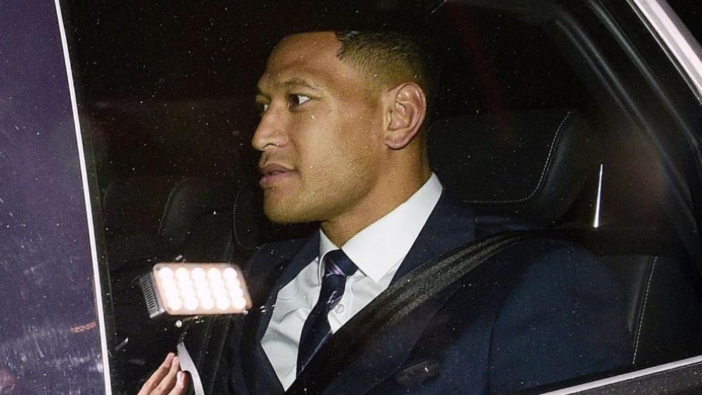 Australian rugby union player Israel Folau leaves a Code of Conduct hearing in Sydney. (AAP Image/Bianca De Marchi)