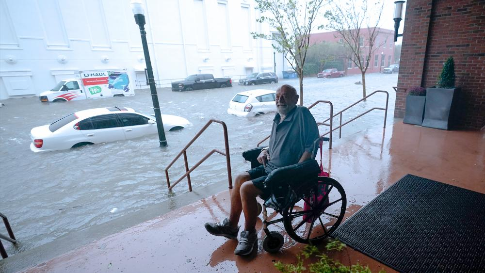 A man watches floodwaters in downtown Pensacola, Fla. Hurricane Sally made landfall Wednesday near Gulf Shores, Alabama, as a Category 2 storm, pushing a surge of ocean water onto the coast and dumping torrential rain