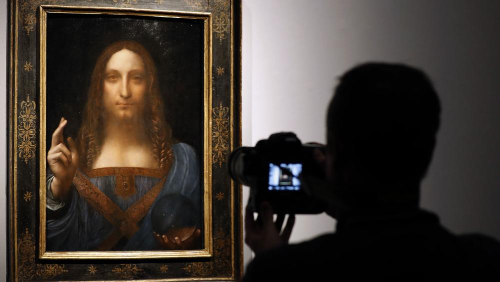 "The ""Salvator Mundi,"" a painting of Jesus Christ attributed to Leonardo da Vinci. (AP Photo)"