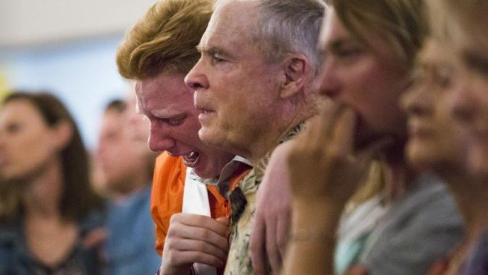 Nathan Jordan, 18, a senior at Alvin High School sobs during the service at Arcadia Baptist Church two days after a shooting that killed 10 people at the Santa Fe High School, Sunday, May 20, 2018, in Santa Fe, Texas.
