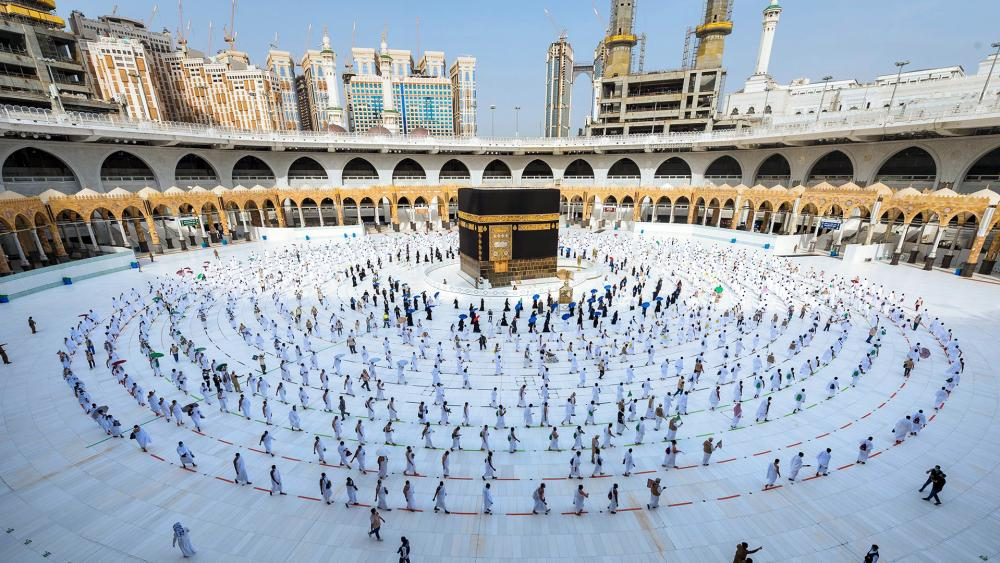 Pilgrims walk around the Kabba at the Grand Mosque, in the Muslim holy city of Mecca, Saudi Arabia, Friday, July 31, 2020.  (Saudi Ministry of Media via AP)