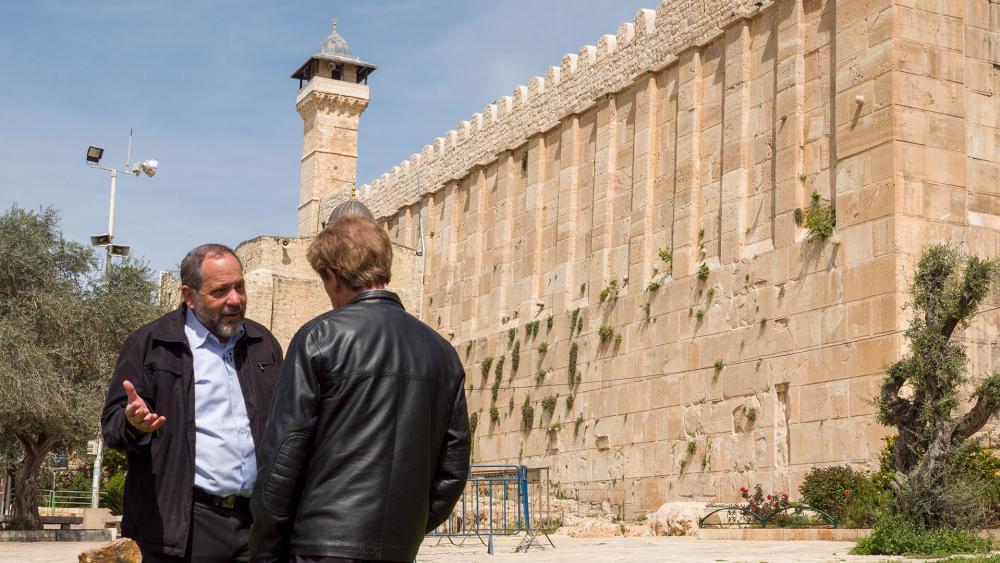 CBN's Scott Ross Speaks with Hebron Jewish Community Spokesman Noam Arnon at the Cave of the Patriarchs, Photo, CBN News, Jonathan Goff