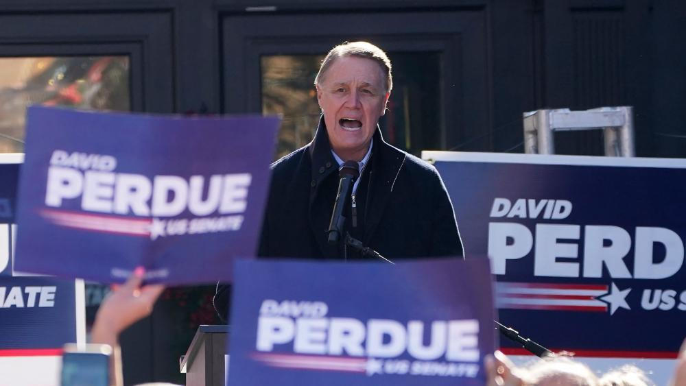 Sen. David Perdue, R-Ga., speaks during a campaign rally, Monday, Dec. 21, 2020, in Milton, Ga. (AP Photo/John Bazemore)