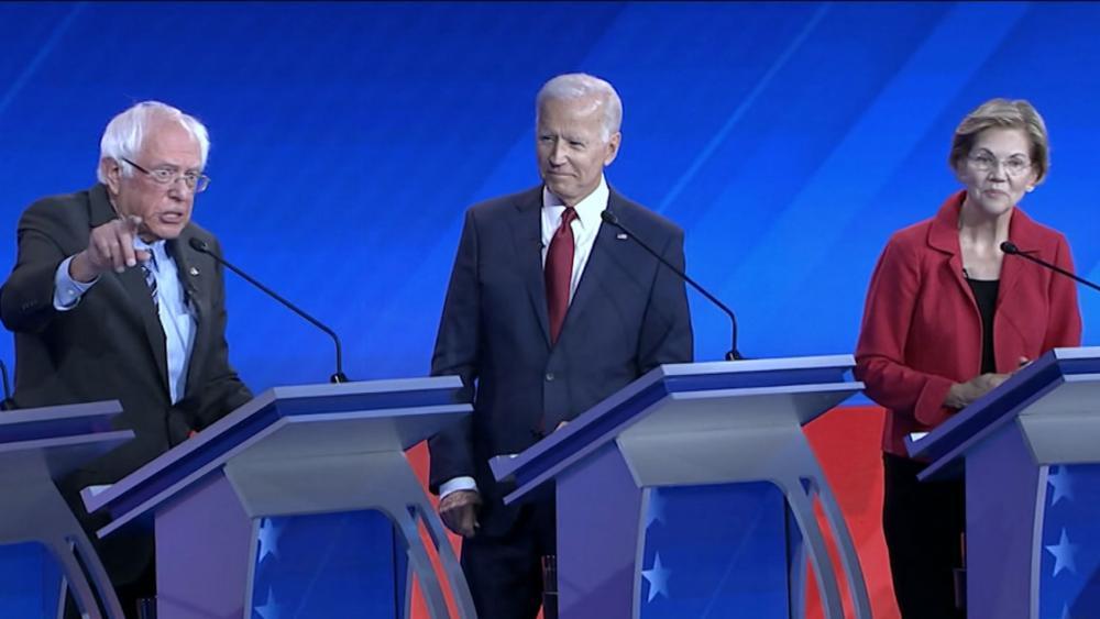 Former Vice President Joe Biden and Sen. Elizabeth Warren (D-MASS) listen to Sen. Bernie Sanders (D-VT) during the third Democratic debate held in Houston, Texas Thursday night. (Image credit: ABC News)