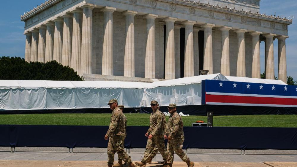 Military service members walk in front of the Lincoln Memorial on Wednesday, July 3 as preparations for President Donald Trump's 'Salute to America' event continue. (Photo credit: Patrick Robertson, CBN News)