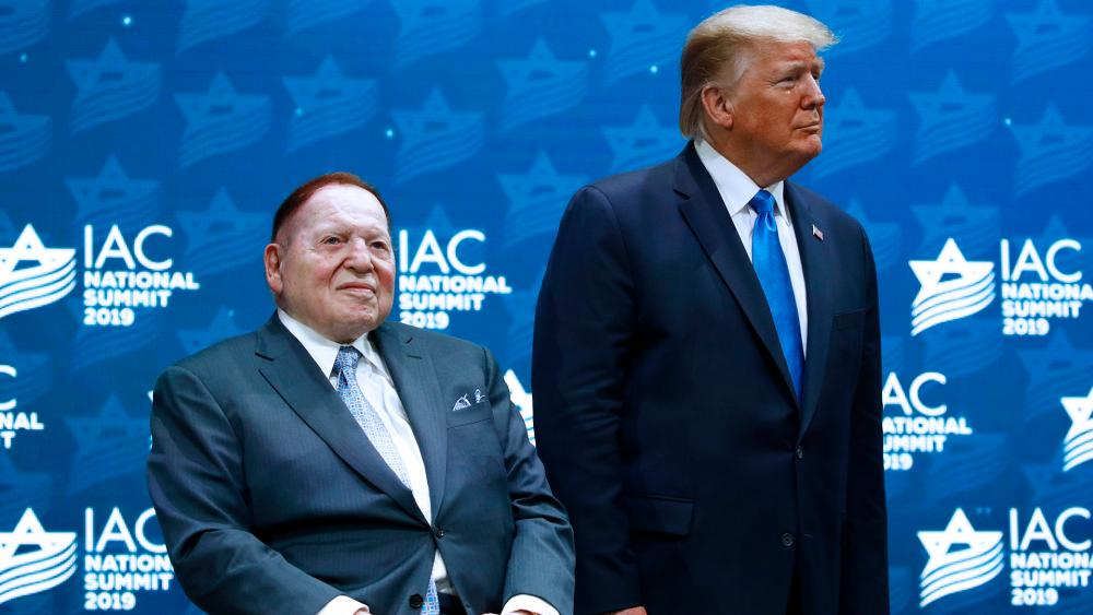 In this Dec. 7, 2019 file photo, President Trump stands alongside Republican mega donor Sheldon Adelson before speaking at the Israeli American Council National Summit (AP Photo/Patrick Semansky, File)