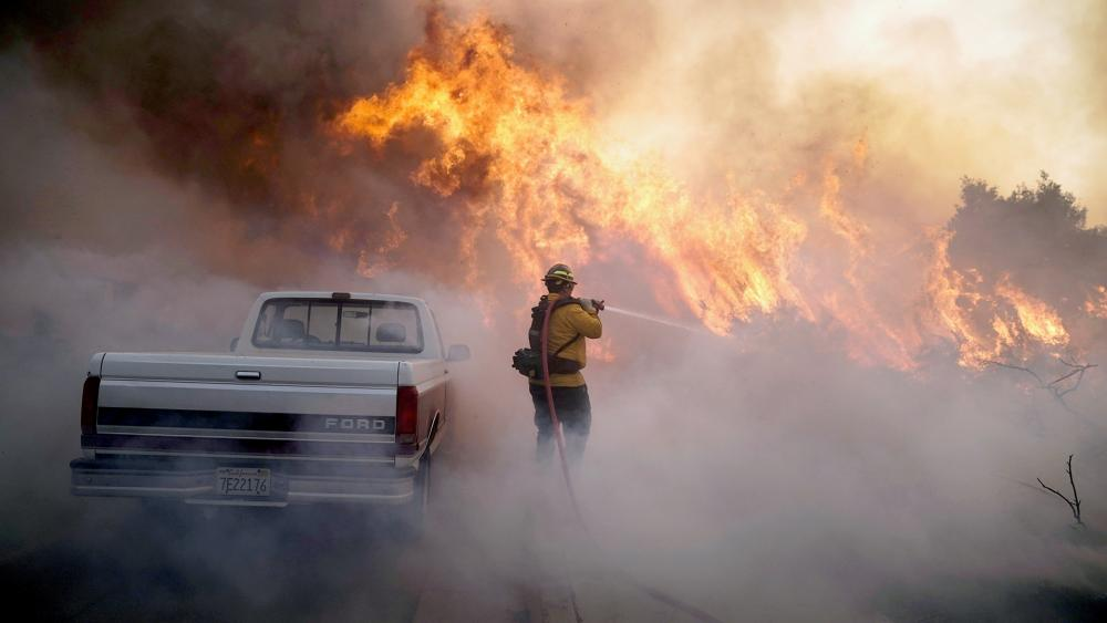 Firefighter Raymond Vasquez battles the Silverado Fire, Oct. 26, 2020, in Irvine, Calif. A fast-moving wildfire forced evacuation orders for 60,000 people in Southern California on Monday (AP Photo/Jae C. Hong)