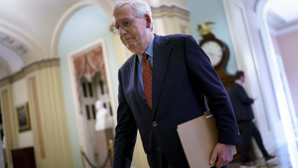 Senate Minority Leader Mitch McConnell, R-Ky., walks to the chamber for a test vote on a government spending bill, at the Capitol in Washington, Monday, Sept. 27, 2021. (AP Photo/J. Scott Applewhite)