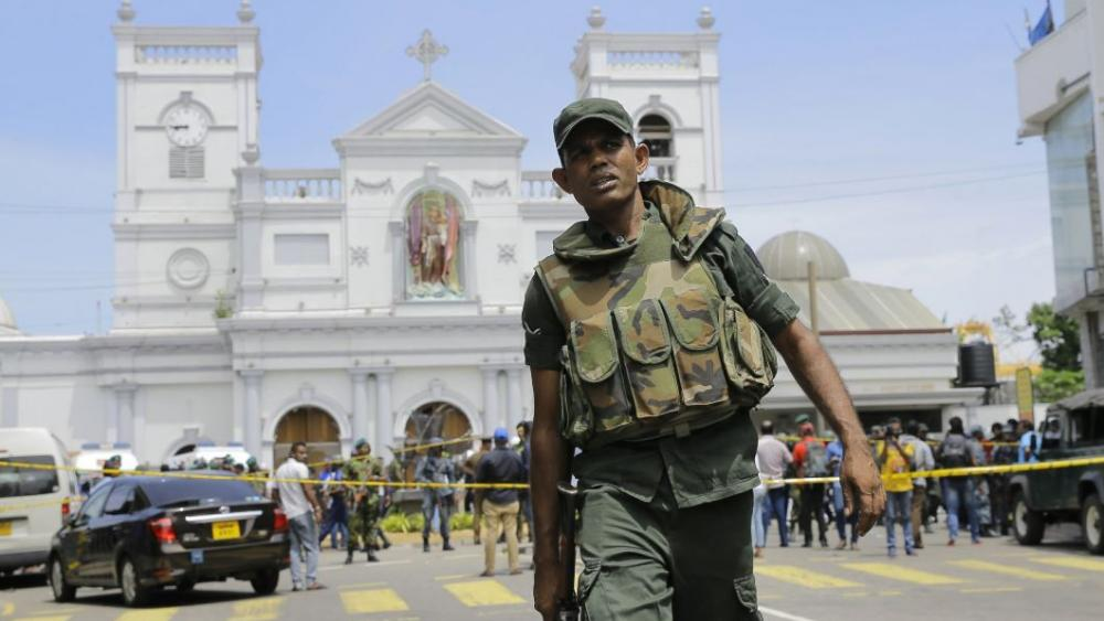 Sri Lankan Army soldiers secure the area around St. Anthony's Shrine after a blast in Colombo, Sri Lanka, Sunday, April 21, 2019. (AP Photo/Eranga Jayawardena)