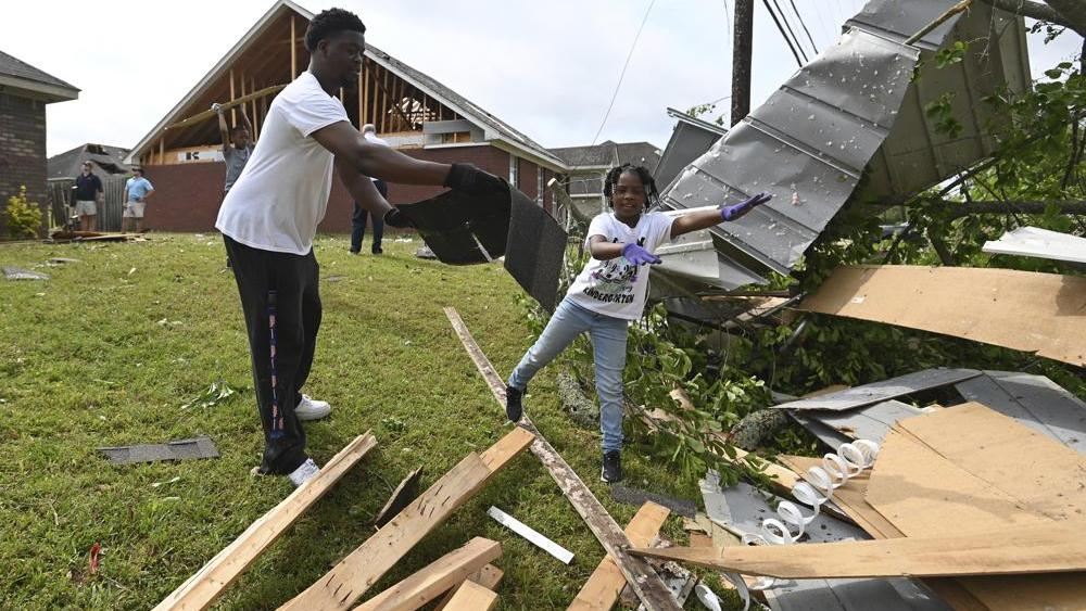 Cleanup efforts underway after multiple storms were reported in Tupelo, Miss., Monday, May 3, 2021. AP Photo/Thomas Graning
