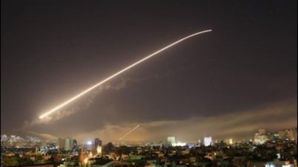 Syria's capital has been rocked by loud explosions that lit up the sky with heavy smoke as U.S. President Donald Trump announced airstrikes in retaliation for the country's alleged use of chemical weapons. (AP Photo/Hassan Ammar)