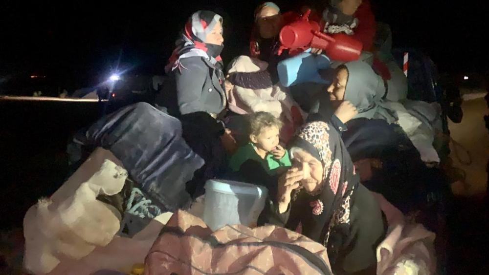 Syrian refugees in the middle of the fighting. (Image credit: Dave Eubank, Free Burma Rangers)