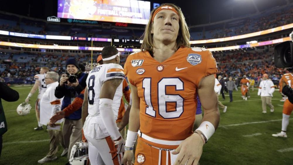 Clemson quarterback Trevor Lawrence (16) is seen following the Atlantic Coast Conference championship NCAA college football game in Charlotte, N.C., Saturday, Dec. 7, 2019. Clemson won 62-17. (AP Photo/Gerry Broome)