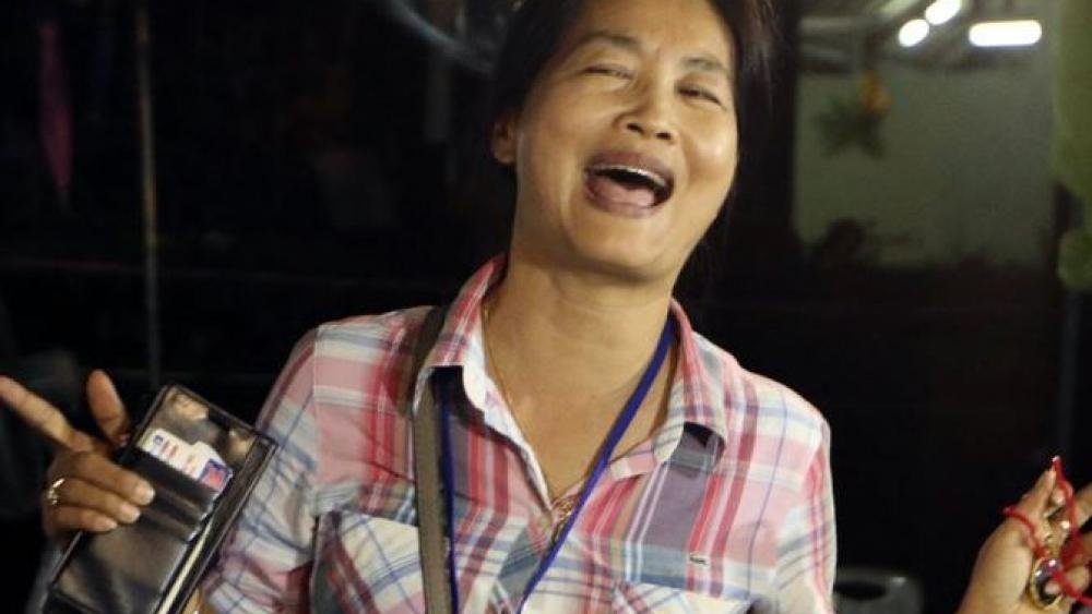 A family member smiles after hearing the news that the missing 12 boys and their soccer coach have been found. AP Photo.