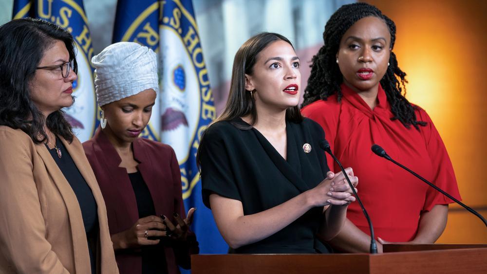 "The progressive ""Squad"" in Congress: Rep. Rashida Tlaib (D-MI), Rep. Ilhan Omar (D-MN), Rep. Alexandria Ocasio-Cortez (D-NY), and Rep. Ayanna Pressley (D-MA) (AP Photo/J. Scott Applewhite)"