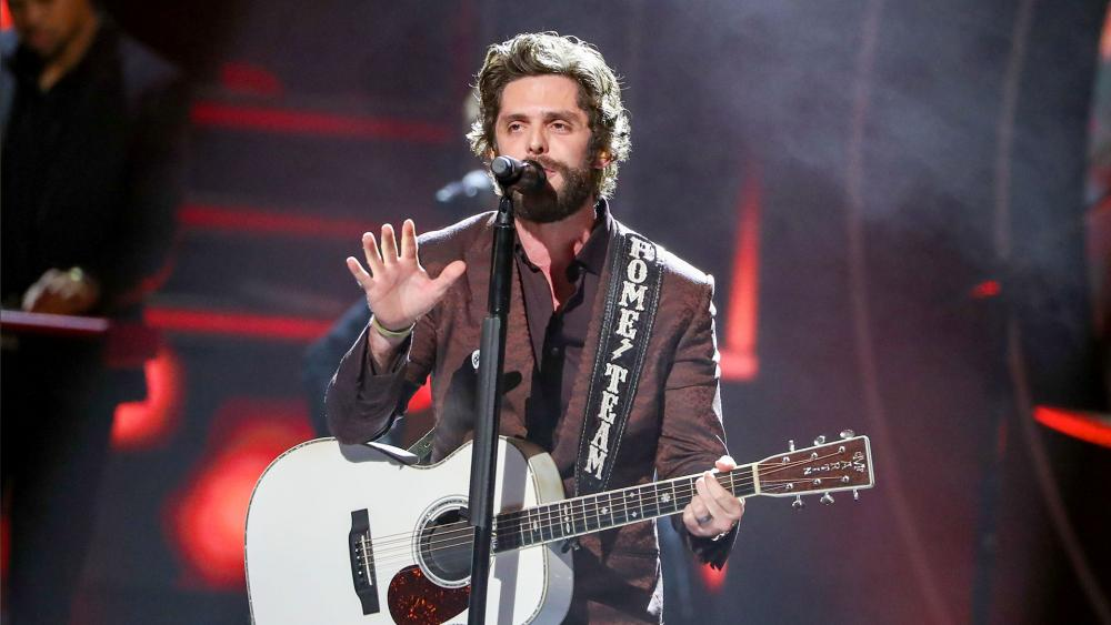While accepting CMT's Artist of the Year award, Thomas Rhett prayed for a grieving fellow Country music star. (Photo by Al Wagner/Invision/AP)
