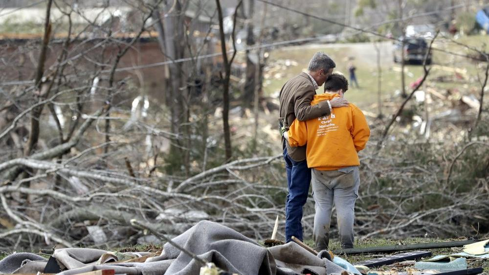 Tennessee Gov. Bill Lee, left, prays near Cookeville, Tenn. after tornadoes ripped across Tennessee early Tuesday (AP Photo/Mark Humphrey)
