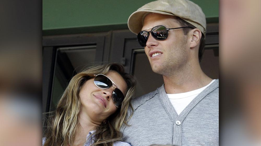 New England Patriots Quarterback Tom Brady and his wife Giselle Bundchen. (AP Photo)