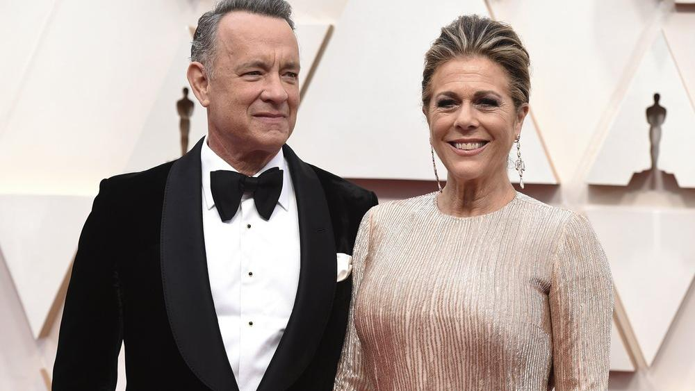 In this Feb. 9, 2020 file photo, Tom Hanks, left, and Rita Wilson arrive at the Oscars at the Dolby Theatre in Los Angeles (Photo by Jordan Strauss/Invision/AP, File)