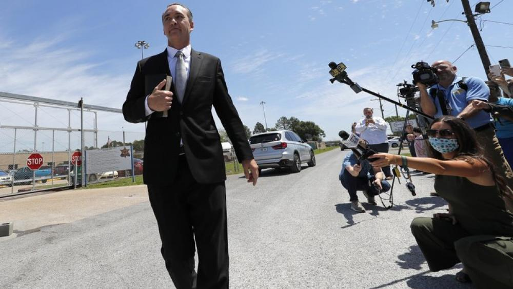 Pastor Tony Spell walks to his church bus as he leaves East Baton Rouge Parish jail on April 21, 2020 (AP Photo/Gerald Herbert)