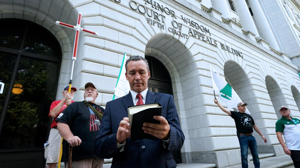 Pastor Tony Spell waits outside the Fifth Circuit Court of Appeals in New Orleans (AP Photo/Gerald Herbert)