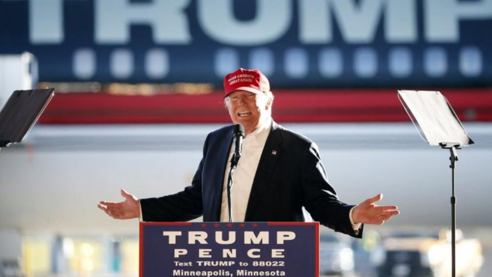 In this Sunday, Nov. 6, 2016 file photo, Republican presidential candidate Donald Trump addresses the crowd during a campaign stop at the Minneapolis International Airport.  (AP Photo/Charles Rex Arbogast)