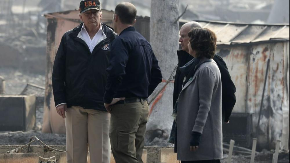 President Donald Trump talks with FEMA Administrator Brock Long, Jody Jones, Mayor of Paradise, and California Gov. Jerry Brown, second from right during a visit to a neighborhood impacted by the wildfires. AP Photo.