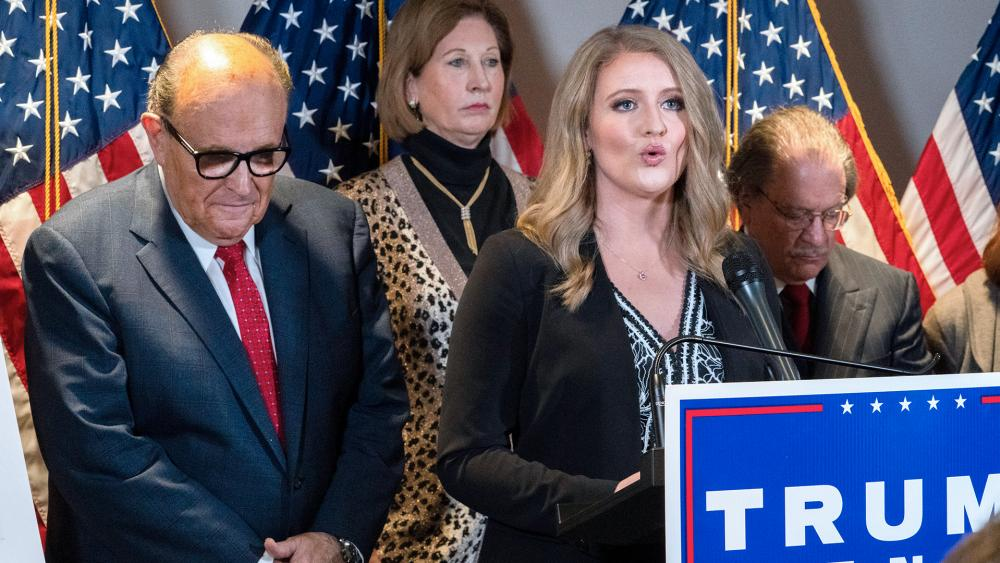Members of President Donald Trump's legal team, including former Mayor of New York Rudy Giuliani, left, Sidney Powell, and Jenna Ellis, speaking on Nov. 19, 2020, in Washington. (AP Photo/Jacquelyn Martin)