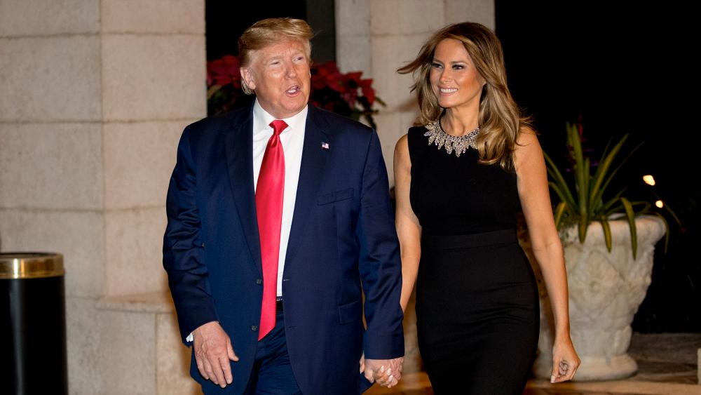 President Donald Trump and first lady Melania Trump on Christmas Eve in Palm Beach, Fla., Dec. 24, 2019. (AP Photo/Andrew Harnik)