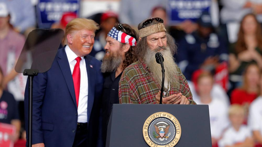 Trump campaigns in Louisiana with reality TV stars Phil and Willie Robertson of Duck Dynasty. (AP Photo)