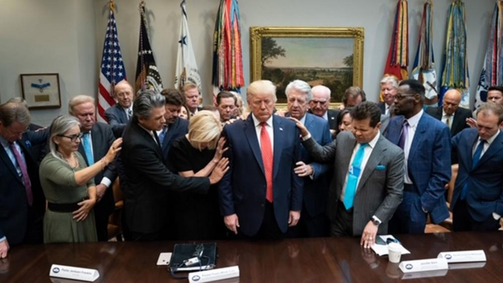 Evangelical leaders pray over President Trump at the White House, October 2019 (AP Photo)