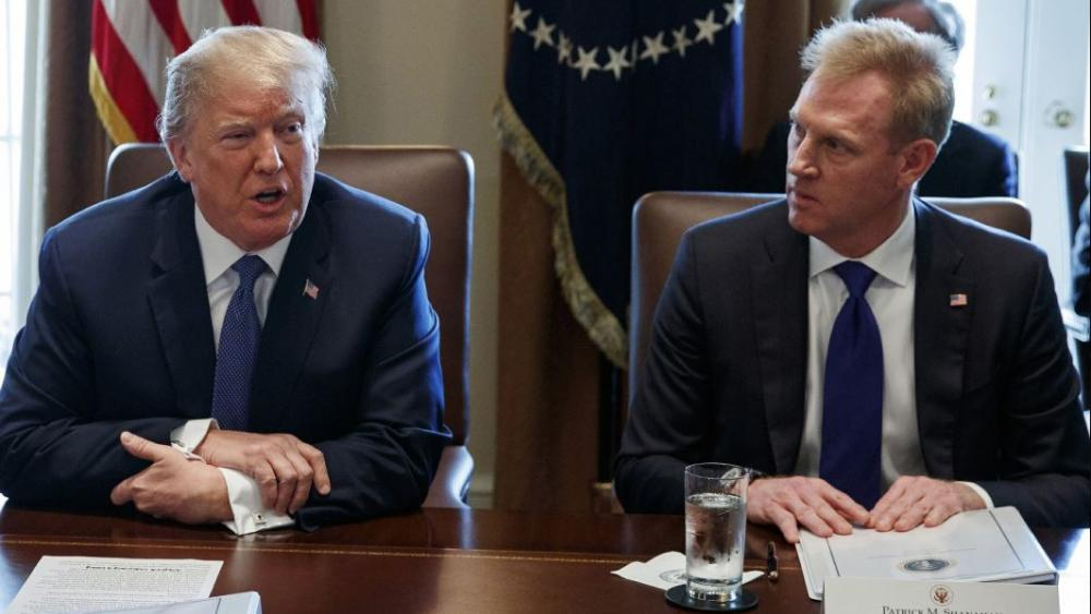 In this April 9, 2018, AP file photo, Deputy Secretary of Defense Patrick Shanahan, right, listen as President Donald Trump speaks during a cabinet meeting at the White House, in Washington.