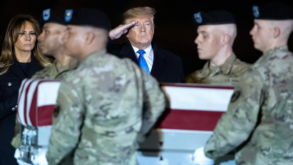 President Trump and first lady Melania Trump went to Dover Air Force Base, Delaware to honor the ultimate sacrifice of US Army of Chief Warrant Officer 2 David C. Knadle, of Tarrant, Texas, Nov. 21, 2019. (AP Photo/Matt Rourke)